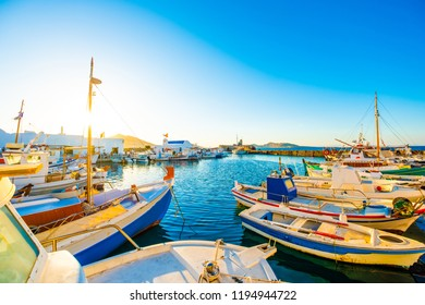 Sunshine view of turquoise bay and colorful yachts at stony berth of greek island Paros