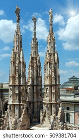 Sunshiny Milan Cathedra roofl (or Duomo di Milano). Construction began in 1386, but it ended only in 1813.