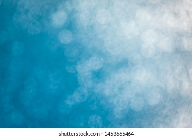 Sunspots on blue water with blur effect background