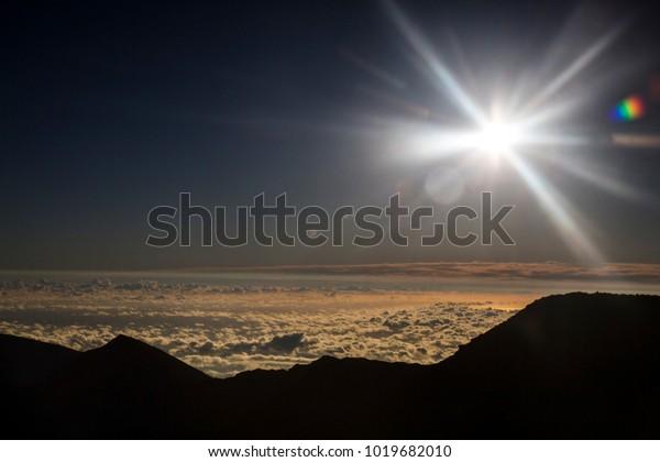 Sunstar and lens flares to the sunrise at Haleakala - Hawaii