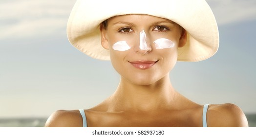 Suntan Lotion Woman Applying Sunscreen Solar Cream.