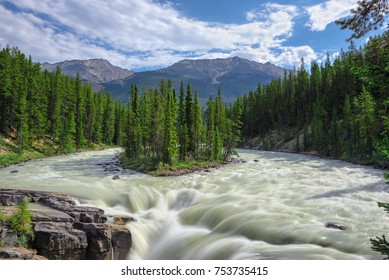 Sunwapta falls and small island on the Athabasca river in Jasper National Park, Alberta, Canada.