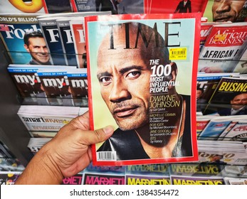 Sunway, Malaysia - 27 April 2019 : Hand hold a TIME Magazine in the book stores with selective focus.