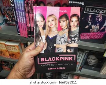 Sunway Piramid, Malaysia - 8 March 2020 : Hand hold a new book - BLACKPINK K-Pop's No. 1 Girl Group for sell in book stores with selective focus.