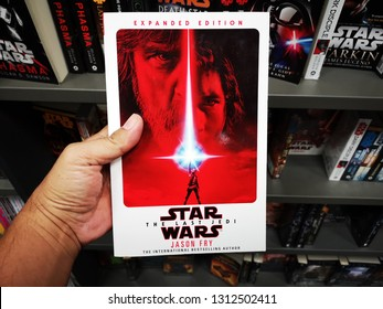 Sunway Piramid, Malaysia - 9 February 2019 : Hand hold a STAR WARS - The Last Jedi by JASON FRY book for sell in the book stores.