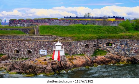 Suomenlinna artillery position and fortress. Lighthouse by the Baltic sea. The destination is the UNESCO Word Heritage site. A popular touristic attraction in Helsinki Finland.