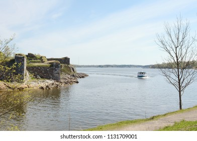SUOMENLINNA, FINLAND - May 14, 2018: Small ferry sails around a bend in Suomenlinna, a small group of islands near Helsinki