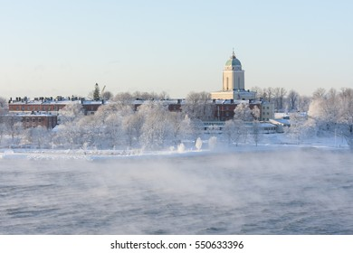 Suomenlinna isle and its buildings in Helsinki, Finland in a steamy sea at winter