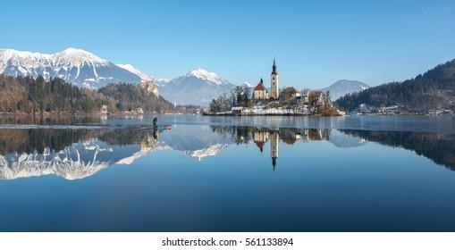 Sup paddling on frozen Lake Bled