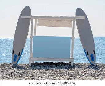 SUP rental station with blank advertising billboard on beach