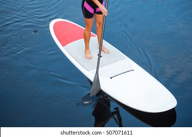 SUP Stand up paddle board woman paddleboarding