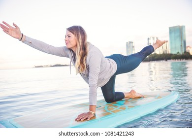 SUP Yoga practice early morning in Waikiki
