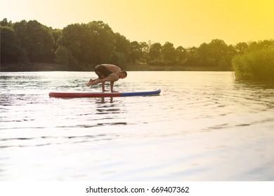 SUP Yoga at a stand up paddling board