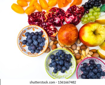 super antioxidants. superfood. mix of fresh fruits and berries, rich with resveratrol, vitamins, raw food ingredients. nutrition background, nutrient-rich foods are good for your heart and brain