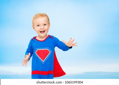 Super Baby in Blue Hero Costume, Happy Child Boy on Sky Background