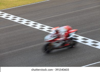 Super bike, motorcycle, motorbike crossing the finish line, Motion blurred.
