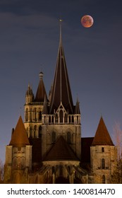 Super Blood Moon lunar eclipse of January 2019 taken from the city of of Lausanne in Switzerland with its Cathedral in the foreground