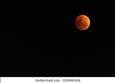 Super Blue Blood Moon on 31 January 2018 in Thailand at 8.32 pm. The rare lunar eclipse, three lunar phenomena (super moon, blue moon and total lunar eclipse) coincide