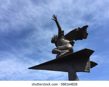 The Super Boy On a Paper Airplane Statue.