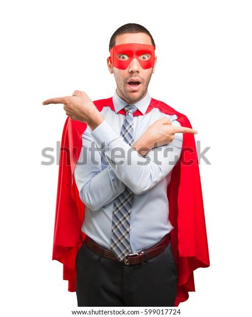 Super businessman pointing