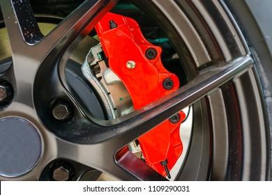 Super Car Brakes. Disc Brake. Disc Pads, Wheel Bearing, Caliper Assembly. Car Brakes Closeup Photo.