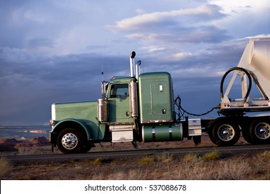 Super classic green truck on the road against the blue sky