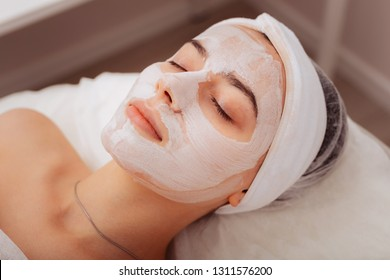 Super effect. Top view of a female mask with a helpful facial mask