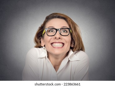 super excited funky girl looking up on grey wall background