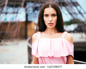 A super fashionable brunette with long hair