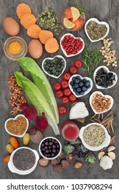 Super food to boost brain power concept with fish, vegetables, fruit, seeds, pollen grain, nuts, supplement tablets, beetroot smoothie juice and medicinal herbs, food  high in omega 3 & antioxidants