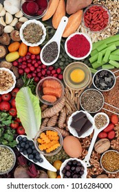 Super food concept to benefit brain power with seafood, vegetables, fruit, seeds, nuts and herbs used in herbal medicine. High in omega 3, vitamins, antioxidants and anthocyanins.