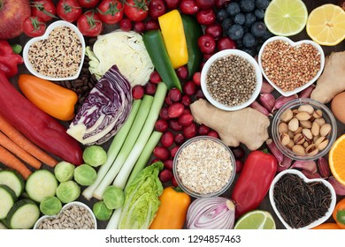 Super food concept for healthy diet with seeds, nuts, fruit, vegetables, cereal, herbs, and grains. Foods high in antioxidants, protein, anthocyanins, dietary fibre and vitamins. Top view.