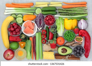 Super food concept for healthy living with fresh salmon, dairy, fruit, vegetables and spices with health foods high in antioxidants, anthocyanins, dietary fibre and vitamins. Top view.