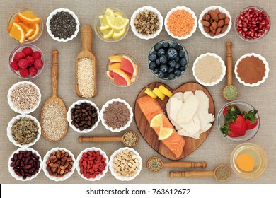 Super food for healthy dieting including fish and meat, fruit, pulses, nuts, cereals and grains with herbs used as appetite suppressants. High in protein, omega 3,  antioxidants, fibre and vitamins.