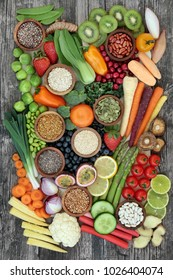 Super food for healthy eating concept with fresh vegetables, fruit, pollen grain, grains, cereals and seeds with food high in omega 3, anthocyanins, antioxidants, dietary fibre, vitamins and minerals.