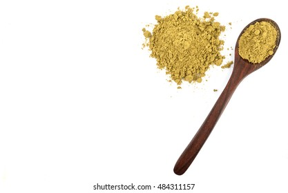 Super food hemp powder in wooden spoon over white background