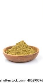 Super food hemp powder in wooden bowl over white background