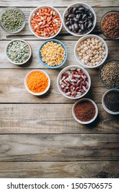 Super food. Raw cereals, grains, legumes, chickpeas, corn, quinoa, hemp, rice against rustic background top view copy space. Vegetarians.