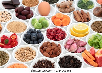 Super food to slow the ageing process concept including fruit, vegetables, seeds, nuts, herbs, spices, green and black teas. Very high in antioxidants, anthocyanins, dietary fibre and vitamins.