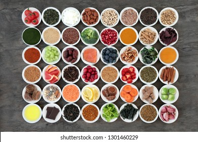 Super food to slow down the ageing process concept including fruit,vegetables,seeds, nuts, herbs, spices, green teas and dairy. High in antioxidants, anthocyanins, dietary fibre and omega 3.