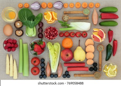Super food for weight loss concept with fruit, vegetables, dairy, nutritional supplements and herbs used as appetite suppressants. Foods high anthocyanins, antioxidants, fibre and vitamins.