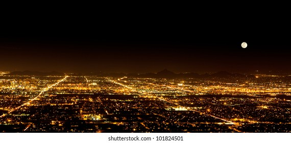 The Super Full Moon on May 5, 2012 over the city light of Phoenix Arizona. Photograph was taken from the top of South Mountain.