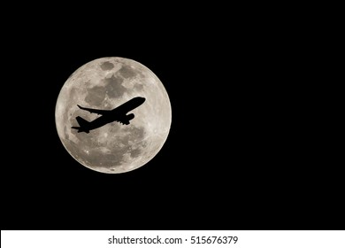 Super full moon over Thailand and silhouette of airplane on November 14, 2016. Isolated on black background