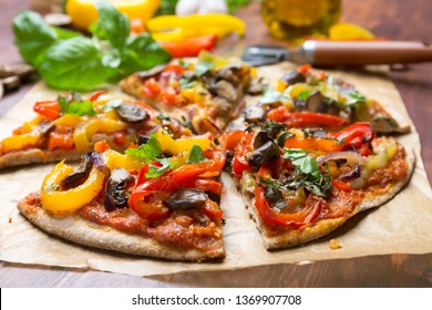 Super Healthy Sliced Vegan Whole Grain Vegetables and Mushrooms Pizza
