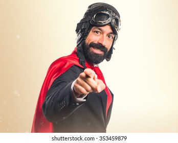 Super hero businessman pointing to the front