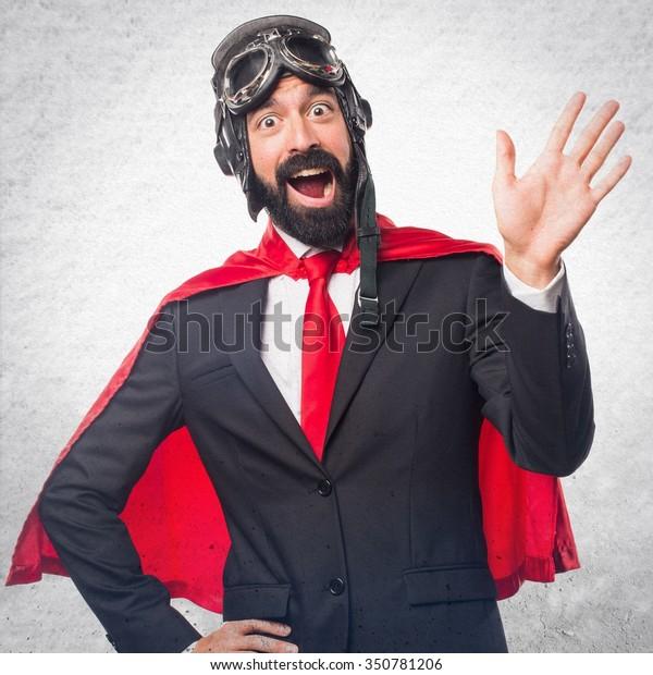 Super hero businessman saluting