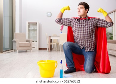 Super hero husband cleaning floor at home