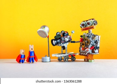 Super hero motion film behind the scenes. Popular blockbuster picture backstage area with main role Superhero clothespin actors, robotic cameraman operator, camcorder on wheels, spotlight. Filmmaking