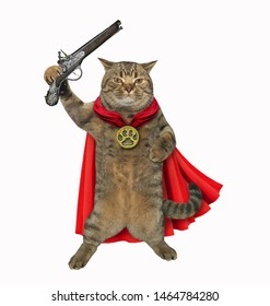 The super hero in a red cloak holds a flintlock pistol. White background. Isolated.