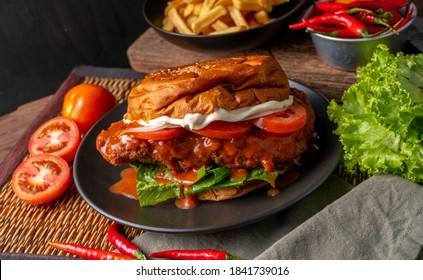 Super juicy Delicious Buffalo Chicken Sandwich. very traditional American style buffalo sauce on deep fried chicken breast with mayo tomato lettuce and buns